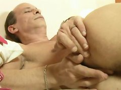 Old man fingers a young man's ass before fucking it