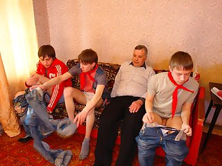 Aged man takes part in a group session with three filthy teen gays