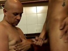 The toned tanned twink is slamming his thick hard cock into his older lover's horny hole