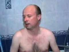 Big old guy spends some great time in the shower with a twink
