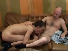 Hot and fucking mad couple of twink and mature gay are having sex on the couch